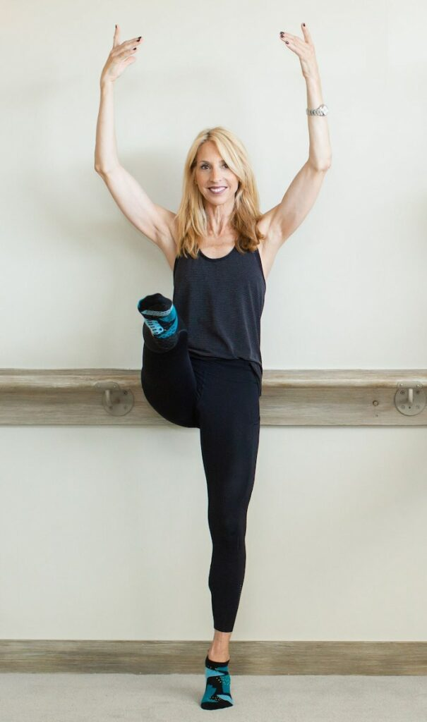 Owner janet in position during barre class