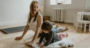 Mom and child holding a yoga position